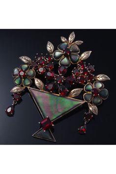 Garnet and opals brooch Joe's birthstone, and the opal the first gem he gave me. would love this for its deeper meaning to me.