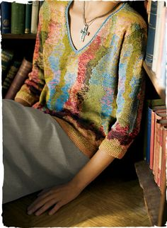 A gorgeous art knit, masterfully handcrafted in brushstrokes of tweeded pima hues—from chambray and blush pink to deep berry, sun-baked gold and spring greens. Detailed with a v-neck, ¾-sleeves and seed-stitched cuffs and hem. Knitwear Fashion, Knit Fashion, Wool Shop, Creative Knitting, Exclusive Clothing, Travel Dress, Sweater Shirt, Peruvian Connection, Creations