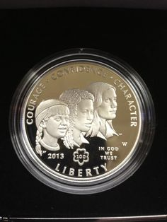 the other side of the 2013 Girl Scout Commemorative Silver Proof Dollar