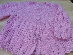 Hand knitted baby girl pink cardigan 6 - 12 months Knitted in a lightweight 'speckled rose' pink and white yarn, this pretty dress has a vintage style lacy pattern to the skirt and sleeves and fastens with three pink teddy head buttons at the front of . Knitted Baby Cardigan, Knitted Baby Clothes, Pink Cardigan, Baby Girl Cardigans, Mixed Babies, Baby Design, Pretty Dresses, Baby Knitting, Pink Girl