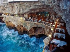 a Mare in southern Italy (province of Bari, Apulia), lies a most unique dining experience at the Grotta Palazzese.Polignano a Mare in southern Italy (province of Bari, Apulia), lies a most unique dining experience at the Grotta Palazzese. Most Romantic Places, Beautiful Places, Amazing Places, Amazing Hotels, Exotic Places, Beautiful Hotels, Beautiful Gorgeous, Stunning View, Beautiful Pictures