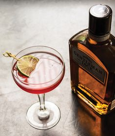 Gentleman Jack® Cranberry Martini    INGREDIENTS    1-1/2 oz Gentleman Jack®  3 oz cranberry juice    HOW TO MAKE IT    Combine first 2 ingredients and shake; strain into a chilled cocktail glass and add 2 dashes bitters. Top with ginger ale and garnish with a lime wedge.
