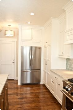 Custom Cabinets: Benjamin Blackwelder Cabinetry, Orem Utah. Cabinet color is 'White Dove' by Benjamin Moore Paints.