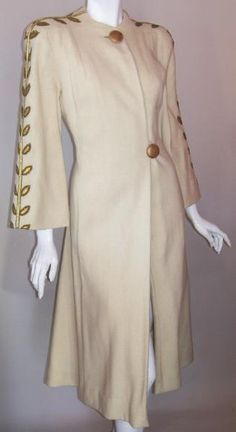 1940s ivory wool coat with gold  leather leaves down shoulders,  sleeves