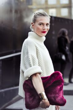 white turtleneck with red clutch/lip punch