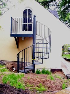 Adorable Pictures Of Circular Staircase Design And Decoration : Beautiful Picture Of Home Exterior Decoration Using Outdoor Black Iron Metal Circular Staircase Including Black Metal Iron Deck Railing And Curved White Wood Glass Exterior Doors