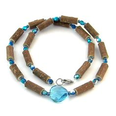 Hazelwood Blue Circle Pendant Necklace! Effective in reducing acid-based ailments and symptoms, such as eczema, acid-reflux, and heartburn, and ulcers. Must be placed directly on the skin and worn 24/7. Made with nylon-coated steel wire, hazelwood and assorted beads, and nickel clasp (lobster style opening).