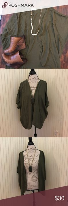 Filly Flare olive flowing cardigan Very lovely and flowing cardigan. Olive color and hidden short sleeves. Textured light cotton blend. XL filly flair Tops Blouses
