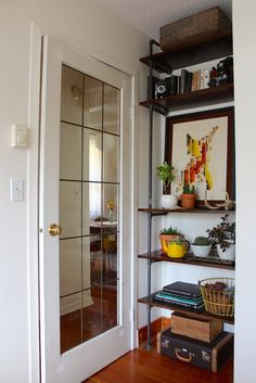 Heather & Eric's Cozy Victoria Cottage House Tour   Apartment Therapy : inspiration - pipe shelves