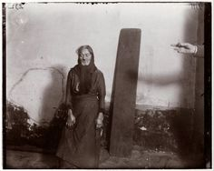 An old woman with the plank she sleeps on at the Eldridge Street Station women's lodging room.