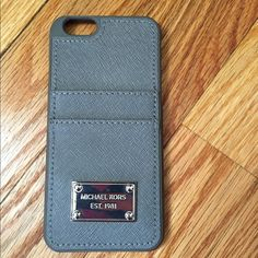 Michael Kors Steel Gray IPhone 6 Case MK steel gray iPhone 6 case. Silver hardware. Credit card slots on back. Used for two days, excellent condition. Price firm unless bundled. Michael Kors Accessories Phone Cases