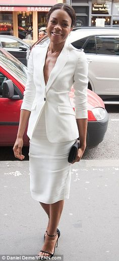Naomie Harris in Burberry suit and clutch, Stuart Weitzman shoes.  (March 2014)