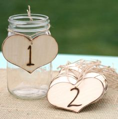 Rustic Table Numbers Vintage Wedding Decor. $44.99, via Etsy. Hang on Ball jars as table centerpieces with flowers or candles - doubles as table numbers for seating (that is if you are seating your guests by table)