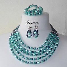 Teal and turquoise faux pearl statement necklace. Comes with matching earrings and bracelet.     Length:    Necklace 18    Bracelet 8.5