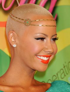 Amber Rose  This lady always looks amazing.  She is wearing the new for winter tangerine orange lips.  Not everyone can wear orange, but she can.