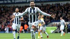 Hal Robson-Kanu celebrates scoring his sides second goal during the Premier League match against Arsenal at The Hawthorns on March 2017 in West Bromwich, England. Arsenal Premier League, Premier League Matches, Sydney Fc, Latest Football News, Sheffield Wednesday, Brentford, West Bromwich, Europa League, The Visitors