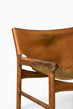 Rare easy chair model 103 designed by Illum Wikkelsø Produced by Mikael Laursen in Denmark Oak and original leather 1960's Good vintage condition, with signs of usage and heavy patina Mid century, …