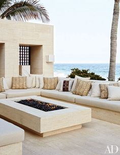 Cindy Crawford and Rande Gerber and George Clooney's Side-By-Side Mexican Villas Outdoor Living Room: Made of Niwala limestone from Spain, the outdoor living room's seating is topped by cushions clad in a Ralph Lauren Home fabric. Terrasse Design, Patio Design, Outdoor Living Rooms, Outdoor Spaces, Outdoor Patios, Living Spaces, Fire Pit Patio, Concrete Fire Pits, Outdoor Kitchen Design