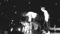 Finally found the GIF of their pyramid. Niall just jumps to the top! LIKE HOW