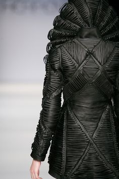 Fabric Manipulation using eyelets & leather laces to create a structured surface; fashion design detail // Iris van Herpen