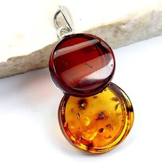 'Sunset Gold' Sterling Silver Natural Baltic Amber Pendant  Price : $49.95 http://www.silverplazajewelry.com/Sunset-Sterling-Silver-Natural-Pendant/dp/B00EA3YFJU