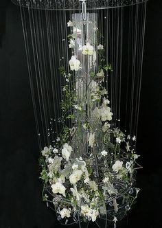 Joe-Massie-Chelsea-FlowerJoe's exquisite design was built using a frame of clear Perspex held up by heavy duty fishing line.  It features an intricate display of white flowers and foliage including phalaenopsis and vanda orchids, aquilegia, matricaria, hellebores, tillandsia, and ceropegia sandersonii.  The design was adorned with Swarovski crystals and weighed 19kg when finished.-Show-2012