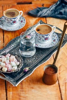 How to Make Turkish Coffee - Coffee Set - Ideas of Coffee Set - Turkish coffee served in a traditional cup on a copper coffee tray photographed with a glass of water and turkish delights on the side. Turkish Coffee Cups, Arabic Coffee, Turkish Tea, Learn Turkish, Coffee Tray, Espresso Coffee, Iced Coffee, Coffee Menu, Espresso Cups