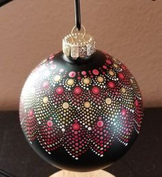 """Delicate painted dot art in metallic colors adorn a deep forest green matte glass ornament.  For the holidays or every day décor.  Acrylic metallic paints in gold (light and medium), red (light and medium) and pearl white.NOTE:  Every effort is made to duplicate the ornament pictured but there is a possibility the design and colors may vary slightly due in part to paint manufacturers.  If you'd like  photos of the ornament you're interested in, I'm happy to send them to you.  Ornament = 4""""… Painted Ornaments, Glass Ornaments, Metallic Colors, Metallic Paint, Christmas Bulbs, Christmas Decor, Christmas Ideas, Red Rose Tea, Mandala Dots"""