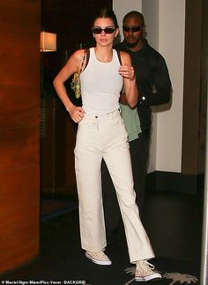 Kendall Jenner stuck with a casual all-white outfit as she left a Miami Beach Hotel. Moments later her newly-reunited boyfriend Ben Simmons left the same hotel.
