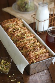 Baklava Pull Apart Bread A rich, moist and nutty dessert bread layered with pistachios, walnuts, honey and cinnamon sugar. Each piece of bread is cut Greek Desserts, Greek Recipes, Bagels, Delicious Desserts, Dessert Recipes, Yummy Food, Gula, Bread And Pastries, Dessert Bread