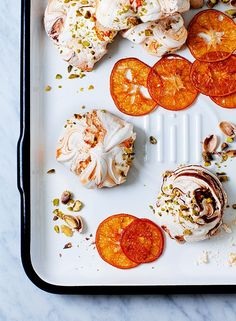 Orange and pistachio meringues