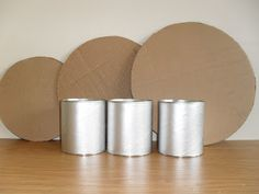 """DIY Cupcake Stand (I'm thinking covered cans for the """"poles"""") But what to use for the base… The post DIY Cupcake stand Tutorial. appeared first on Fashion Ideas – Fashion Trends. Cardboard Cake Stand, Diy Cardboard, Superman Birthday Party, Barbie Birthday, Little Man Birthday, Budget Crafts, Cake And Cupcake Stand, Birthday Party Decorations, Graduation Decorations"""