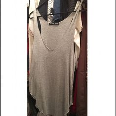 Cute AND comfy tank! NWOT. Perfect for those hot summer days! Look cute without compromising your comfort Adorable paired with distressed jeans or even over a swimsuit. ☀️ Tops Tank Tops