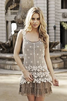Two in one... You can take the two pieces apart and wear them separate! The top Crochet Tank looks adorable with a cream tank & light pink cozy cardigan! (Don't forget to accessorize!)