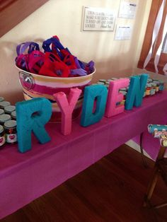 Name Ryden - letters wrapped in yarn on display at sign-in table. Ryden's first birthday #owlparty