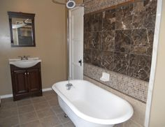   Second remodeled bathroom with clawfoot tub, new vanity, and tile ...