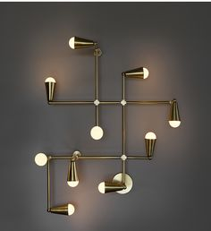 Zig-Zag wall and ceiling fixture in solid brass.