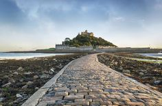 Iconic castle topped St Michael's Mount on a small island acroos the causeway from the south west tip of Cornwall, near to Penzance in south west England