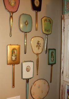 Vintage mirror collection display.... took my mom's collection to Hobby Lobby and had them put them in a shadow box to hang in her bathroom over the tub... it's big but love it.
