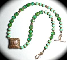 Hill Tribe silver necklace with turquoise rondelles and green vintage crystals.