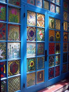 Hand Painted windows at La Fonda in New Mexico. I would love to have a set of doors like this in my home with my original designs.