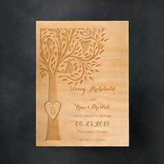 A whimsical tree filled with hearts stands tall on the left side of this etched-wood save the date; perfect for a rustic-themed wedding!
