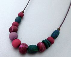 Polymer bead leather necklace, teal and berry colors, purple leather cord, antiqued brass parts, handmade beads one-of-a-kind, bead jewelry