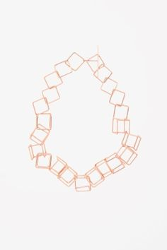 Metal cube necklace