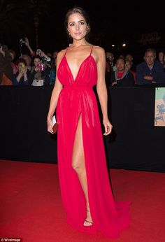 Former Miss USA and Miss Universe winner Olivia Culpo wore a vibrant floor-length gown in Cannes http://dailym.ai/1qp79oi