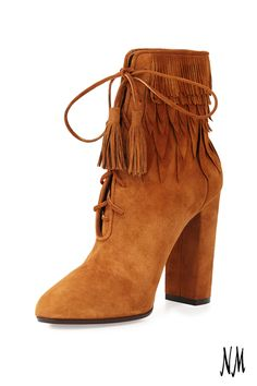 These Woodstock Aquazzura Fringe Booties will unveil your inner flower child. Elevate your look with a lace-up front and fringed tassel ties that echo the 70's.