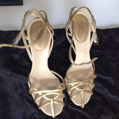 Gucci gold leather sandals Ankle strap sandals. Have been worn, but I've replaced the heel peg and re-soled the foot cushion as you can see in the picture. They come with the Gucci dust bag. Gucci Shoes Sandals
