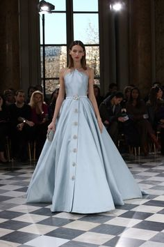 Belted and buttoned, this shimmering blue, halter-neck ball gown makes a statement. #GEORGESHOBEIKA Couture #SS2016 #parisfashionweek #hautecouture #Couture #paris #pfw #dress #accessories #monnaiedeparis