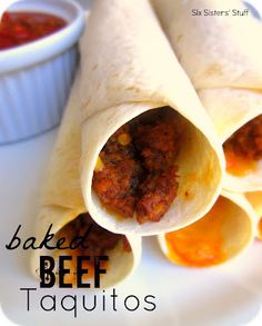 Baked Beef Taquitos....With a carb balance tortilla and extra lean ground beef these wouldn't be that bad for you!