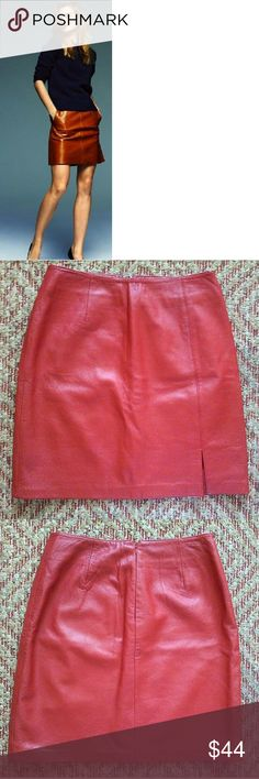 """Willi Smith 100% Lamb Leather Red A line Skirt ✳Willi Smith Collection ✳100% lamb leather skirt ✳Dark red color ✳Unconstructed waistline ✳100% Polyester lining ✳Bottom left front slit ✳Rear zipper, metal hook/eye closure (hook slightly bent. Still works!) ✳Very slight wear upper front left (pic #4) and middle of skirt but too small to photograph. Wanted to mention. ✳Size 6 ✳Measurements (lying flat): 13 1/2"""" waist across, 19"""" length from top to bottom  Stock photo for styling purposes…"""